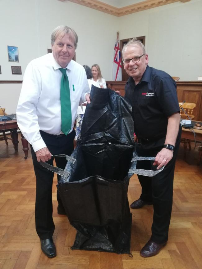 NEW SCHEME: Cllr Peter Clayton and Cllr Nick Tolley with one of the new gull proof rubbish bags