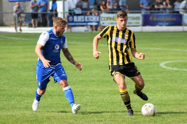 Helston Athletic's Matt Bye and Falmouth Town's David Broglino during a pre-season friendly in 2019