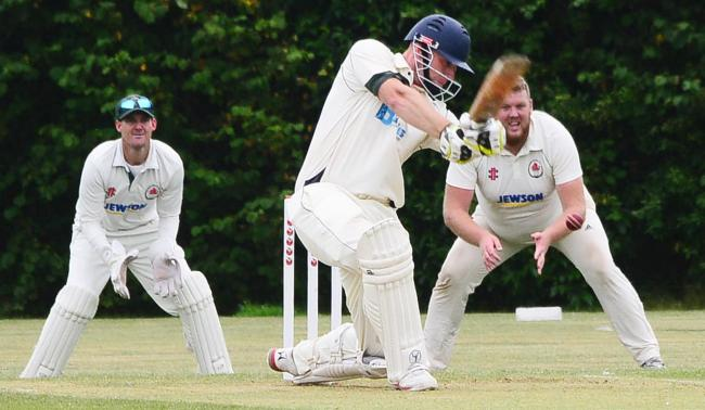 STRIKE: Lewis Knight at the crease for North Petherton against Minehead on Saturday. Pic: Steve Richardson