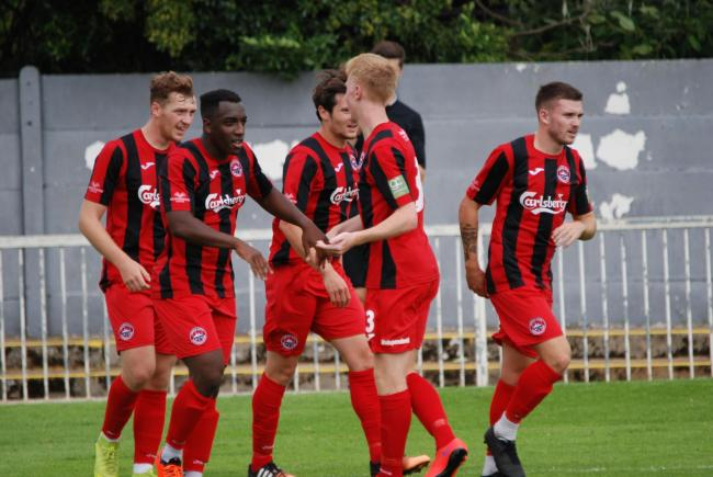 The Truro City players celebrate Niall Thompson's goal during their 2-0 win at Met Police. Picture by Cameron Weldon