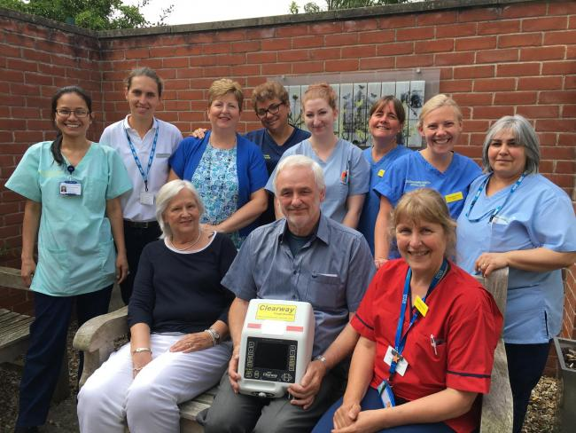 GRATEFUL: Paul Wood hands over the cough assist machine to hospital staff