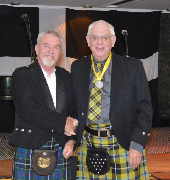 Paul Phillips receiving an award from Grand Bard Merv Davy last year