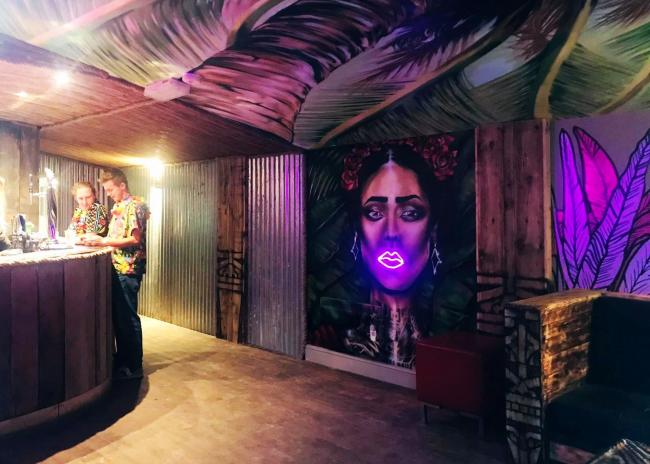 The inside bar area, complete with a mural of Frida Kahlo