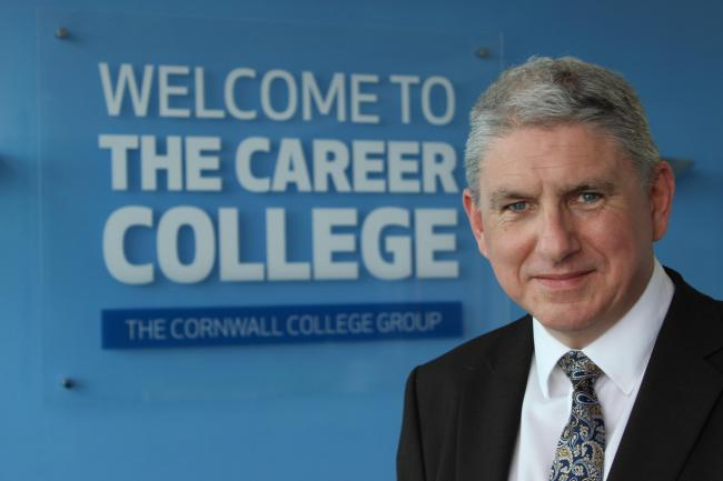 New college CEO John Evans