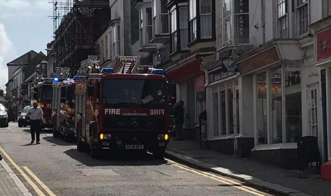 Three fire engines called to incident in town centre shop