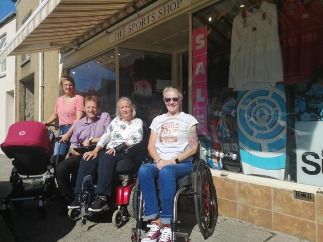 Derek Thomas MP out on the streets of Helston with wheelchair users