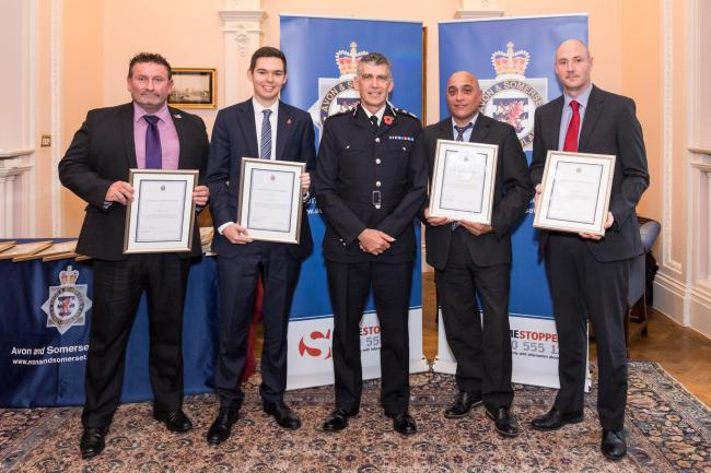 AWARDS: The police team which investigated the attack on Mr Booth
