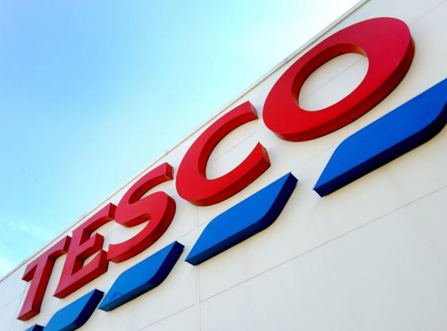File photo dated 26/08/16 of a Tesco sign, as the supermarket is to remove one billion pieces of plastic from products by the end of 2020 as it seeks to reduce its environmental impact, the UK's biggest retailer has announced. PA Photo. Issue date: Fr
