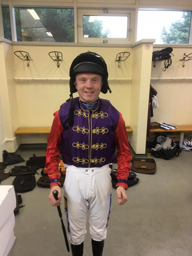 WINNER: Tom Buckley in the Queen's racing silks