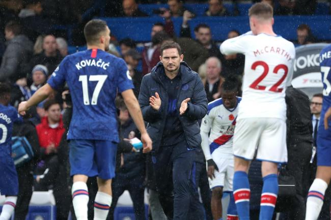 Frank Lampard, centre, applauds his team after victory over Crystal Palace