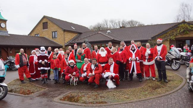 SANTA BIKERS: Last year's riders after arriving at Little Bridge House