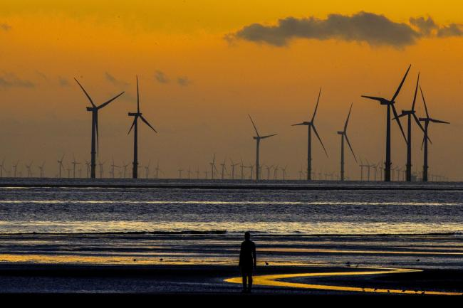Offshore wind farms helped set the record on Sunday (Peter Byrne/PA)