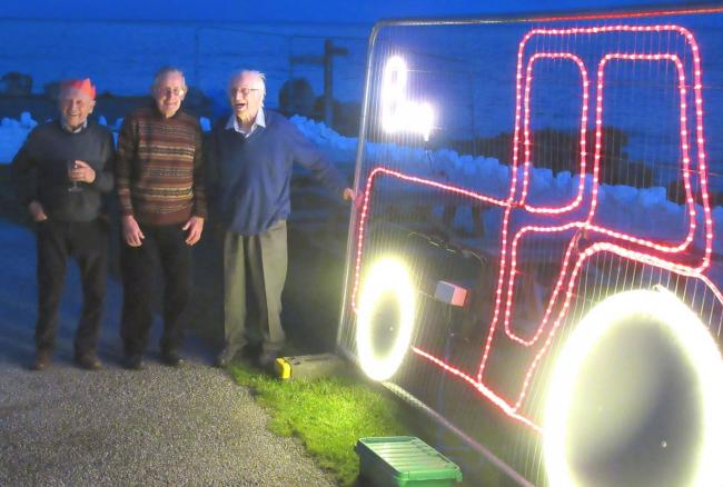 Ben Roskilly with the new tractor light, joined by other long-standing lights supporters John Tripconey and George Watters