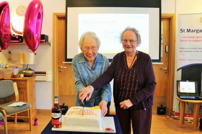 WELCOME BACK: June Fenn and Elizabeth Yates at the hospice's 40th birthday tea