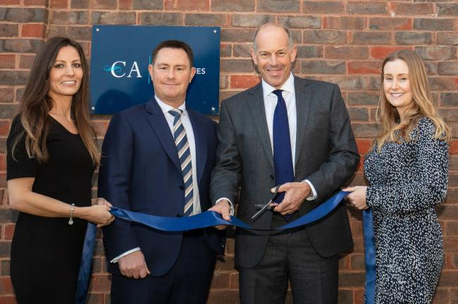 OPEN FOR BUSINESS: Phil Spencer with Cooper Associates' directors Diana Cooper, Lee Cooper and Samantha Jackson