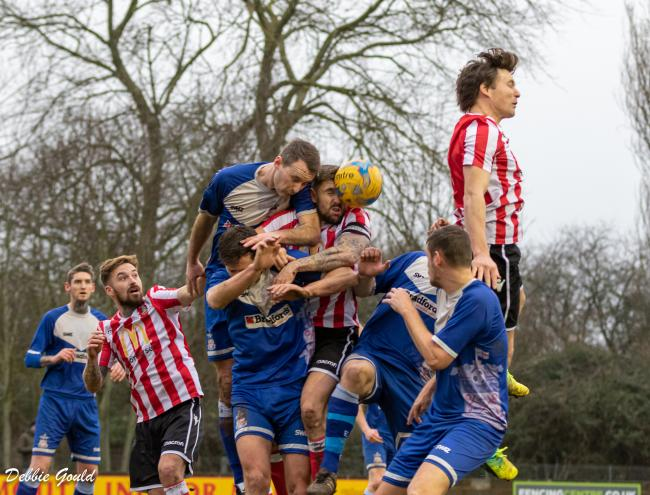 LEAP: Owen Irish (right, red and white kit) gets up high during Bridgwater Town's draw at Exmouth. Pic: Debbie Gould