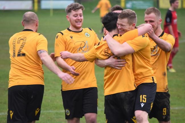 Porthleven players celebrate Kyle Fraser's late winner against Sticker