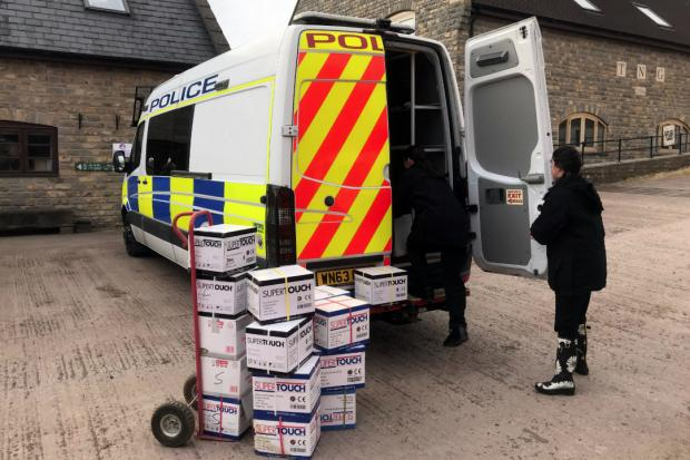 COLLECTION: Police staff collecting the donations from Worthy Farm, home of Glastonbury Festival