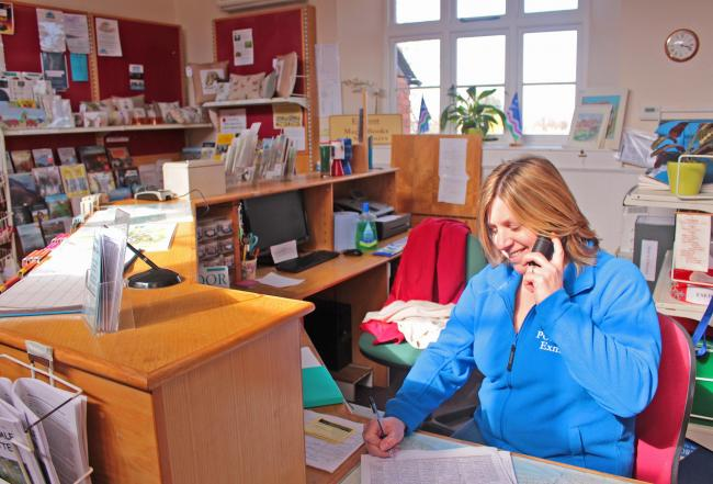 HELPING HAND: Volunteer Clare Gladstone mans the Porlock Community Initiative Helpline. Photo by Chris Gladstone