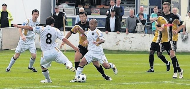Marcus Martin takes the ball off Les Afful to fire Truro City into a 1-0 lead against Dover. Pic: Richard Augarde