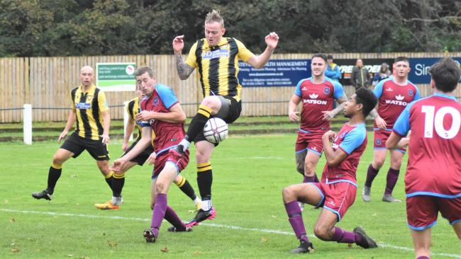 Tom Annear (centre) scored the first goal of his second spell with Falmouth Town on Saturday