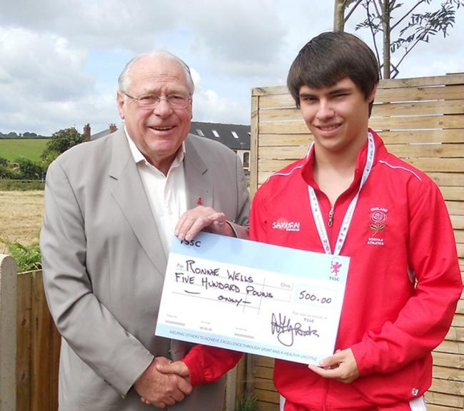 Alan Gloak, TS5C chairman, presenting a grant cheque to one of the charity's young athletes, Ronnie Wells