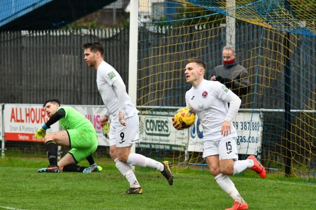 Rocky Neal grabs the ball after scoring one of his two goals in Truro City's win on Saturday. Picture: Cameron Weldon
