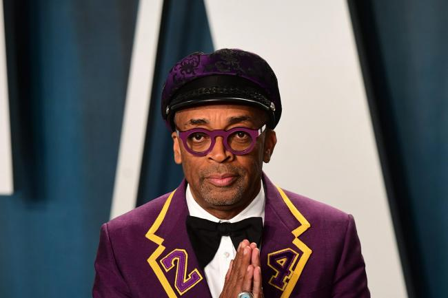 Spike Lee maintains a neutral expression towards the camera
