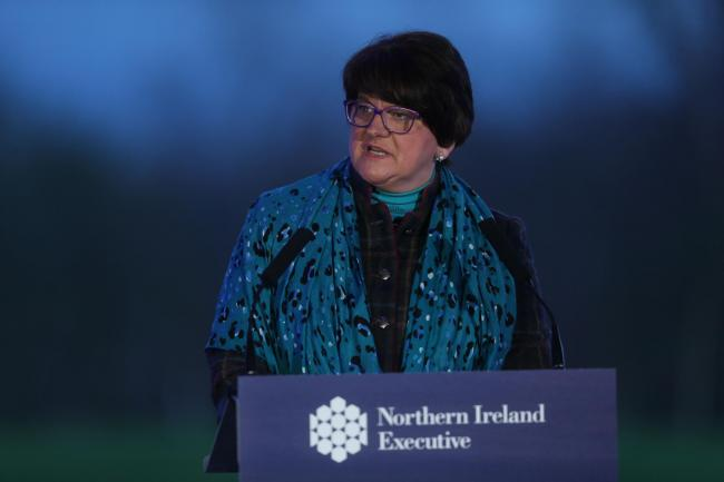 First Minister Arlene Foster speaks while standing at a lectern