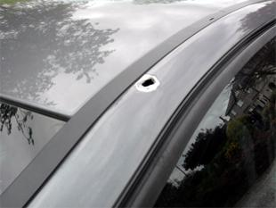 This is The West Country: DAMAGE:The 'bullet hole' left in the bodywork of the car in which Katie Higgins was travelling