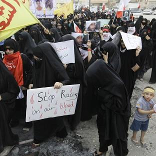 Bahraini anti-government protesters carry anti-F1 signs during a march ahead of the Formula One grand prix (AP)