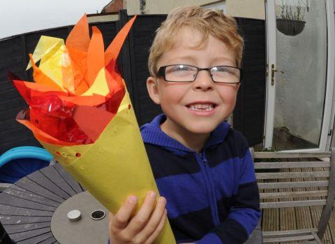 LOGAN McKerrow is selling the torch he made at school on eBay to raise funds for Hearing Dogs for Deaf Children. PHOTO: Jeff Searle.