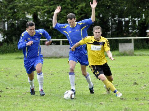 Ryan McErlain and Kyle McErlain (blue) chase down a John Smith XI player. PHOTO: Mike Lang