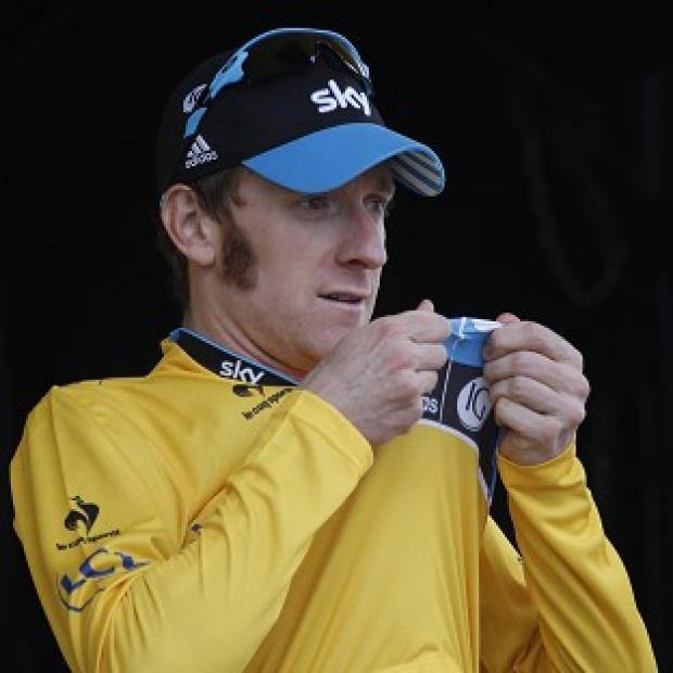 Bradley Wiggins the overall leader's yellow jersey on the podium of the 19th stage of the the Tour de France (AP/Laurent Rebours)