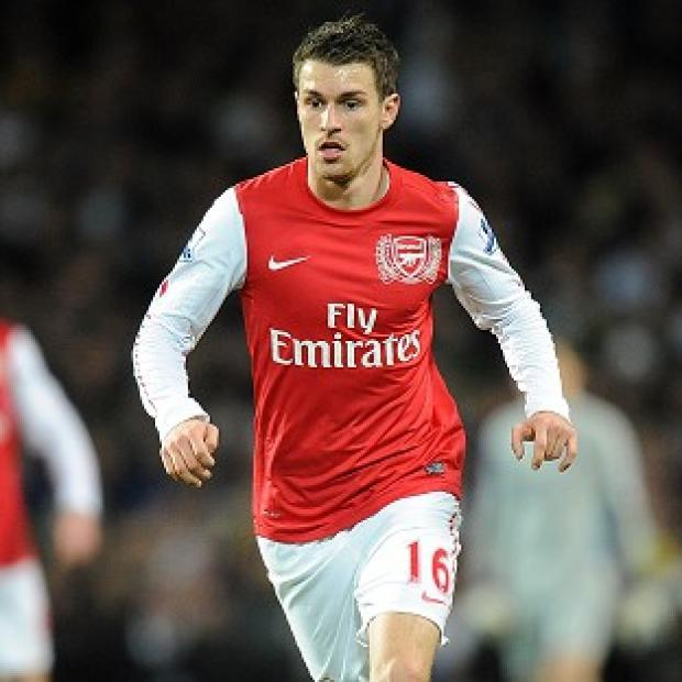 Aaron Ramsey, pictured, recognises Robin van Persie's worth to Arsenal