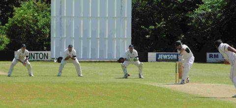 Steffan Jones bowls to an eager slip corden of, from left, Andy Hallaran, Michael Coles and Stuart Standerwick. PHOTO: Geoff Hall