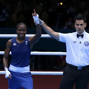 Great Britain's Nicola Adams defeats India's Chungneijang Mery Kom Hmangte during the Olympics women's boxing flyweight semi-final