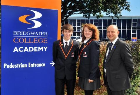Head boy Scott Kilday, 15, head girl, Chelsie Coombes, 15, with executive head teacher Peter Elliott. Photo: Jeff Searle