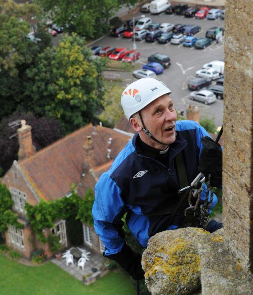 Rev Rod Corke starts making his way down the 168ft tower of St Mary Magdalene Church. PHOTO: Geoff Hall