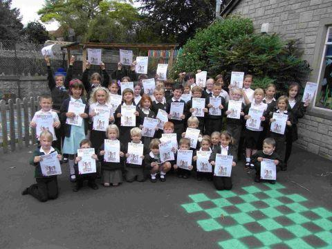 Children show off their certificates and medals