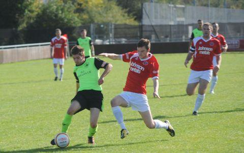 Phil Veal (red shirt) in action against Hemel Hempstead earlier this season