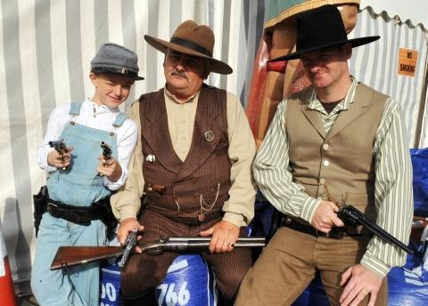 Cowboys descend on Brean with Nick McWilliams, seven, granddad Paul McWilliams and Steven Hanslip. Photo: Jeff Searle
