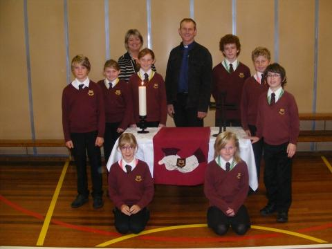 Richards Neill (Vicar) and Jenny Venning (Headteacher) with some of the pupils from Hugh Sexey School. Photo: submitted.