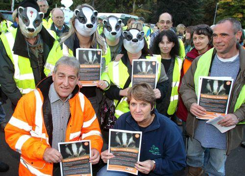 Adrian Coward from the Somerset Badger Group and Pauline Kidner from Secret World, which organised the event, with protesters at Dunster. PHOTO: Steve Guscott