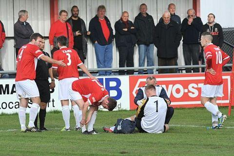 Players appeal to the referee to disallow the goal. PHOTO: Jeff Searle