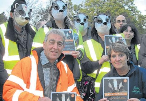 Adrian Coward, chairman of the Somerset Badger Group, and Pauline Kidner, founder of Secret World, with protesters at the Badger Night Walk in Dunster