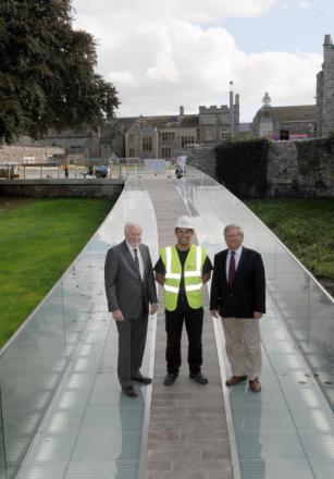 Deane Council leaders Cllr John Williams, site foreman Rob Dunn and Project Taunton's Ian Franklin on the completed Castle Green bridge.