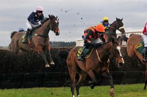 A.P.McCoy and Ruby Walsh in action at Taunton Racecourse Family Fun Day Meeting