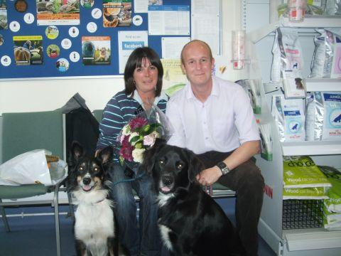 Vet Jason Holt with thousandth customer Mrs Ringwood and her two dogs, Harvey and Kara.