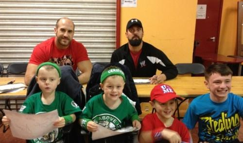 Wrestlers Antonio Cesaro and Damien Sandow met the Shopland boys - from left to right, Theo, Jake, Ajay and Liam.
